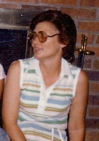 A photo of my mother in her 50's probably. Looking to her right, was cropped from a photo with other people.